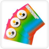 badges monteret på postkort